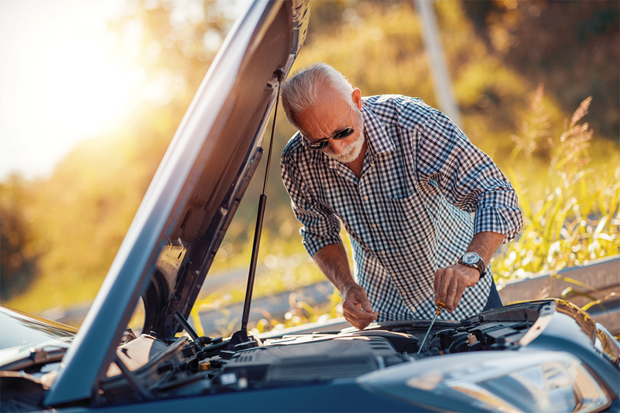 Car Owner Performing Auto Maintenance