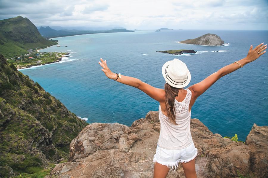 Traveler overlooking a bay