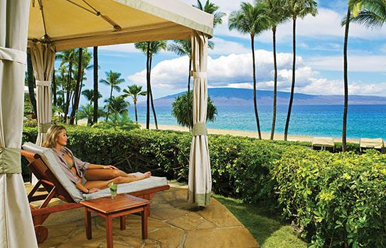 Traveler on a Beach - Inclusive Hawaii Vacation Packages