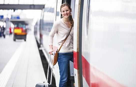 Traveler boarding a train with luggage