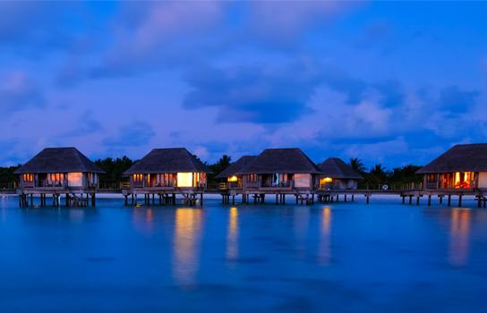 Fiji overwater bungalows at dusk