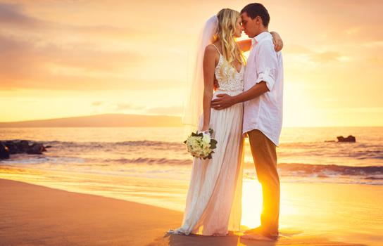 Destination Wedding and Honeymoon Travelers on a Beach