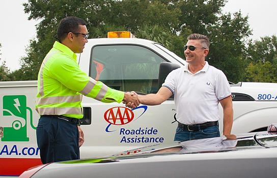 AAA Tow truck driver delivering roadside assistance