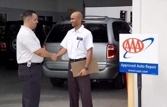 AAA Minneapolis Member shaking hands with a AAA Approved Auto Repair mechanic shop owner