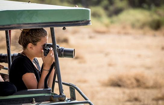 Adventure traveler taking photography in East Africa