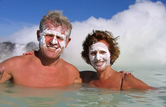Wellness travelers in a hot spring in Iceland