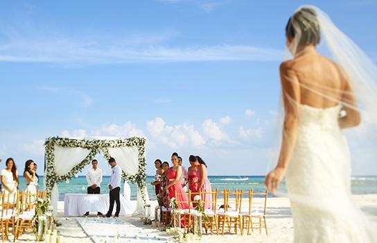 Destination wedding ceremony on an ocean beach