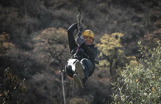 Adventure traveler ziplining in Southern Africa