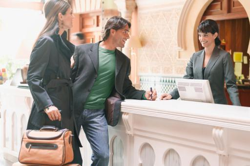 Travelers with luggage at hotel check-in