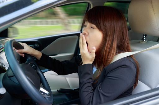 Drowsy driver yawning while driving